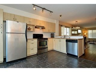 "Photo 3: 34 15155 62A Avenue in Surrey: Sullivan Station Townhouse for sale in ""Oaklands in Panorama Place"" : MLS®# F1442815"