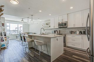 Photo 6: 205 8530 8A Avenue SW in Calgary: West Springs Apartment for sale : MLS®# A1080205