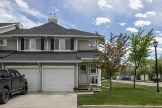 Photo 2: 120 Country Village Manor NE in Calgary: Country Hills Village Row/Townhouse for sale : MLS®# A1114216