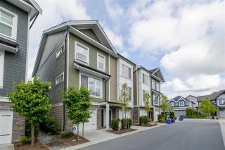 """Photo 1: 33 21150 76A Avenue in Langley: Willoughby Heights Townhouse for sale in """"HUTTON"""" : MLS®# R2579518"""