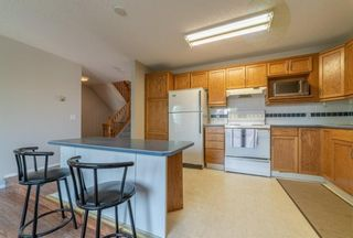 Photo 7: 21 RICHELIEU Court SW in Calgary: Lincoln Park Row/Townhouse for sale : MLS®# A1013241