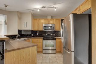 Photo 2: 2308 8 BRIDLECREST Drive SW in Calgary: Bridlewood Condo for sale