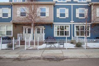 Photo 2: 1204 10 AUBURN BAY Avenue SE in Calgary: Auburn Bay Row/Townhouse for sale : MLS®# A1065411