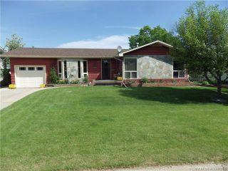 Photo 1: 5026 55 Avenue: Rimbey Detached for sale : MLS®# A1095467