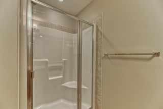 Photo 17: 539 Panatella Walk NW in Calgary: Panorama Hills Row/Townhouse for sale : MLS®# A1125854