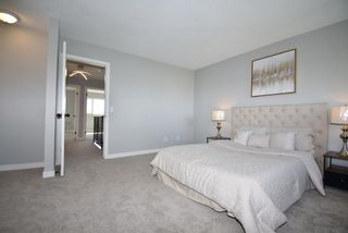 Photo 20: 5 903 67 Avenue SW in Calgary: Kingsland Row/Townhouse for sale : MLS®# A1115343