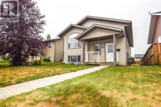 Photo 1: 14 Taylor Drive in Lacombe: House for sale : MLS®# A1131183