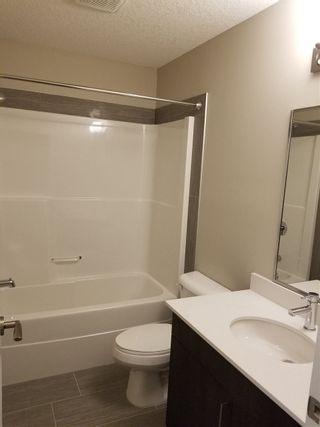 Photo 7: #308 17 COLUMBIA AV W: Devon Condo for sale