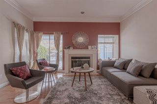 """Photo 2: 242 WATERLEIGH Drive in Vancouver: Marpole Townhouse for sale in """"LANGARA SPRINGS"""" (Vancouver West)  : MLS®# R2344704"""