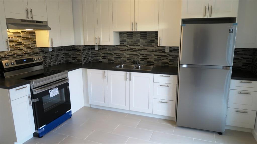 NEW Kitchen ,Stainless steel Appliances,Tile flooring.
