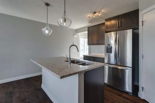 Photo 11: 527 Sage Hill Grove NW in Calgary: Sage Hill Row/Townhouse for sale : MLS®# A1082825