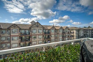 """Photo 24: 407 19936 56 Avenue in Langley: Langley City Condo for sale in """"Bearing Pointe"""" : MLS®# R2616051"""