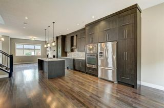 Photo 2: 1609 Broadview Road NW in Calgary: Hillhurst Semi Detached for sale : MLS®# A1136229