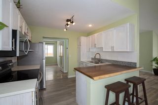 Photo 7: 152 Harrison Court: Crossfield Detached for sale : MLS®# A1098091