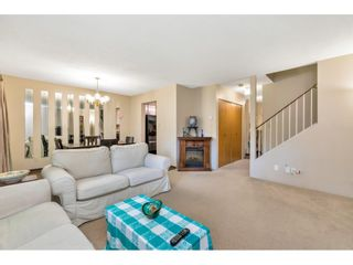 """Photo 4: 103 7349 140 Street in Surrey: East Newton Townhouse for sale in """"Newton Park"""" : MLS®# R2464654"""