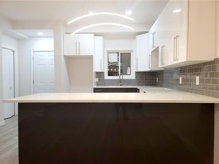 Photo 12: 1049 A Magnus Avenue South in Winnipeg: Shaughnessy Heights Residential for sale (4B)  : MLS®# 202124669