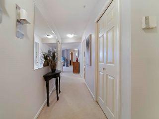 "Photo 3: 113 15155 22 Avenue in Surrey: Sunnyside Park Surrey Condo for sale in ""Villa Pacific"" (South Surrey White Rock)  : MLS®# R2576826"