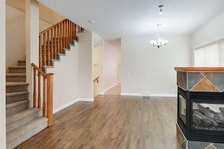 Photo 3: 4111 Garrison Boulevard SW in Calgary: Garrison Woods Row/Townhouse for sale : MLS®# A1108505