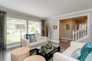 Photo 5: 23 FLAVELLE Drive in Port Moody: Barber Street House for sale : MLS®# R2599334