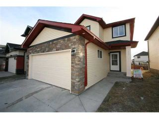 Photo 2: 300 SADDLEMEAD Close NE in CALGARY: Saddleridge Residential Detached Single Family for sale (Calgary)  : MLS®# C3500117