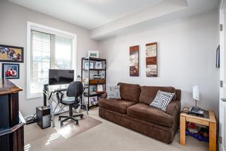 Photo 11: 2408 15 Sunset Square: Cochrane Apartment for sale : MLS®# A1123430