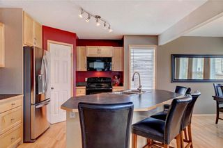 Photo 8: 51 COVECREEK Place NE in Calgary: Coventry Hills House for sale : MLS®# C4124271