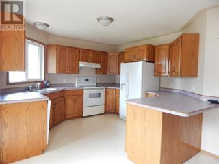 Photo 7: 10317 99 Avenue in High Level: House for sale : MLS®# A1130617