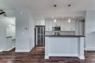 Photo 2: 2 2120 35 Avenue SW in Calgary: Altadore Row/Townhouse for sale : MLS®# C4285073