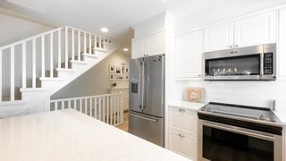 """Photo 10: 8402 KEYSTONE Street in Vancouver: Champlain Heights Townhouse for sale in """"Marine Woods"""" (Vancouver East)  : MLS®# R2606648"""