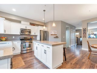"""Photo 12: 21008 80 Avenue in Langley: Willoughby Heights Condo for sale in """"KINGSBURY AT YORKSON SOUTH"""" : MLS®# R2562245"""