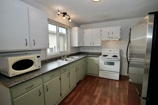 Photo 3: 11427A 8 Street SW in Calgary: Southwood Row/Townhouse for sale : MLS®# A1035689