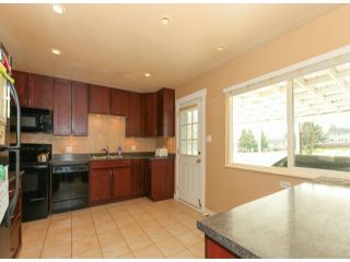 Photo 7: 1860 ROUTLEY AV in Port Coquitlam: Lower Mary Hill House for sale : MLS®# V1095195