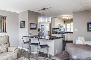 Photo 5: 243 Parkwood Close SE in Calgary: Parkland Detached for sale : MLS®# A1134335