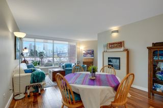 """Photo 2: 209 1490 PENNYFARTHING Drive in Vancouver: False Creek Condo for sale in """"Harbour Cove 3"""" (Vancouver West)  : MLS®# R2560559"""