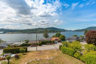 Photo 1: 1007 IOCO Road in Port Moody: Barber Street House for sale : MLS®# R2593092