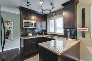 Photo 2: 40 Sackville Drive SW in Calgary: Southwood Detached for sale : MLS®# A1128348