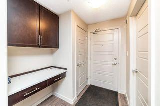 Photo 2: 203 5510 SCHONSEE Drive in Edmonton: Zone 28 Condo for sale : MLS®# E4237061
