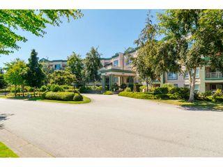 "Photo 2: 322 13880 70 Avenue in Surrey: East Newton Condo for sale in ""Chelsea Gardens"" : MLS®# R2348345"