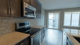 Photo 5: 250 Sunset Point: Cochrane Row/Townhouse for sale : MLS®# A1050873