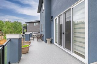 Photo 45: 313 KINNIBURGH Cove: Chestermere Detached for sale : MLS®# A1118572