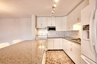 Photo 10: 509 55 ARBOUR GROVE Close NW in Calgary: Arbour Lake Apartment for sale : MLS®# A1096357