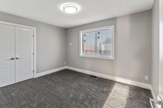 Photo 21: 211 Kinniburgh Place: Chestermere Detached for sale : MLS®# A1078763