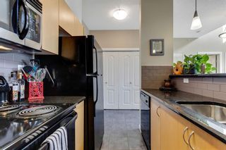 Photo 5: 1409 604 East Lake Boulevard NE: Airdrie Apartment for sale : MLS®# A1057063