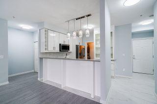 """Photo 1: 216 13277 108 Avenue in Surrey: Whalley Condo for sale in """"Pacifica"""" (North Surrey)  : MLS®# R2472406"""