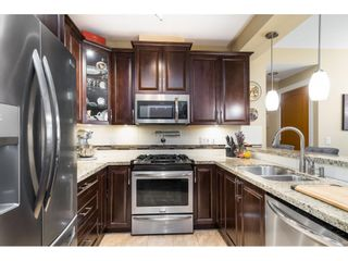 """Photo 4: A409 8218 207A Street in Langley: Willoughby Heights Condo for sale in """"Yorkson Creek (Final Phase) Walnut Ridge"""" : MLS®# R2597596"""