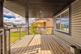 Photo 5: 410 Boulder Creek Way SE: Langdon Detached for sale : MLS®# A1128135