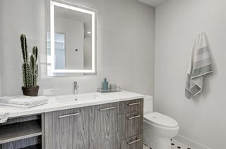 Photo 14: 102 1709 35 Avenue SW in Calgary: Altadore Row/Townhouse for sale : MLS®# A1030241