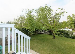 Photo 3: 2 6408 BOWWOOD Drive NW in Calgary: Bowness Row/Townhouse for sale : MLS®# C4241912