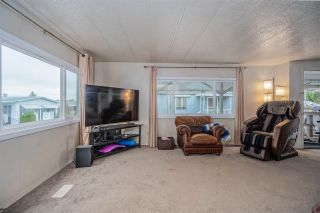 """Photo 2: 24 8254 134 Street in Surrey: Queen Mary Park Surrey Manufactured Home for sale in """"WESTWOOD ESTATES"""" : MLS®# R2508251"""
