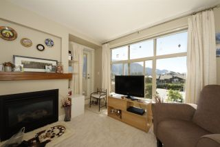 """Photo 4: 318 1211 VILLAGE GREEN Way in Squamish: Downtown SQ Condo for sale in """"ROCKCLIFF AT EAGLEWIND"""" : MLS®# R2372303"""